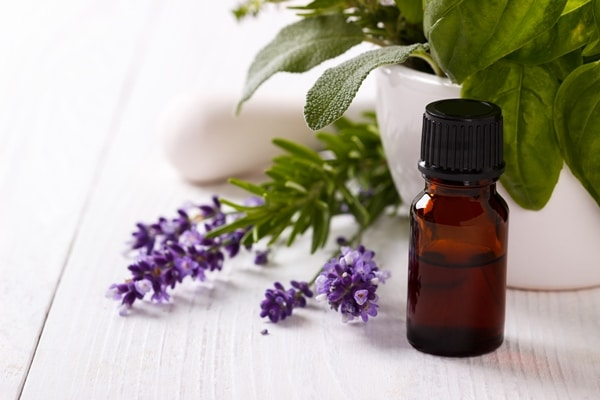 A bottle of lavender essential oil used for aromatherapy helps with sleep.