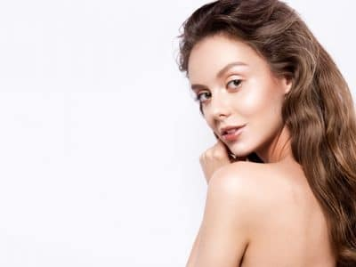 Beautiful woman with glowing skin on the face and body