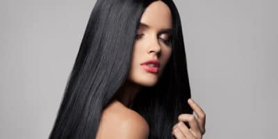 Beautiful woman with long black shiny hair
