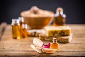 Bottles of essential oils including castor oil for hair care treatment