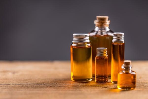 Bottles of pure castor oil in wooden table