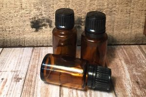 Three bottles of castor oil; amber glass bottles