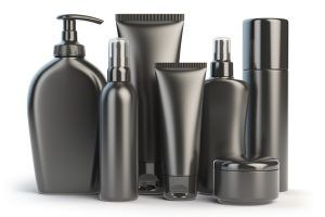 Set of body care products in black containers; white background