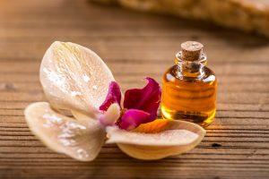 Bottle of argan oil on wooden surface