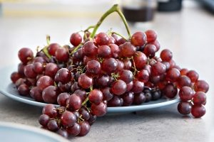 Ripe grapes in a white platter