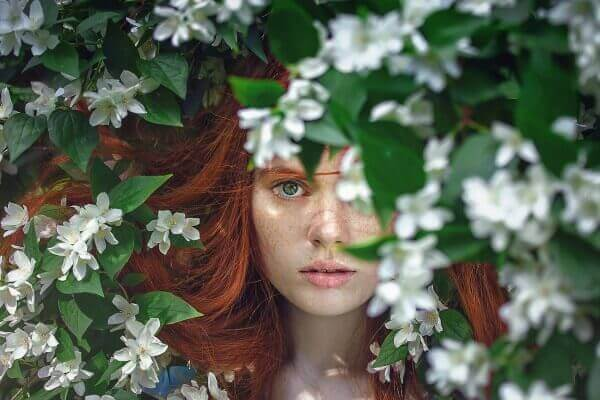 Red-haired girl with dry strands