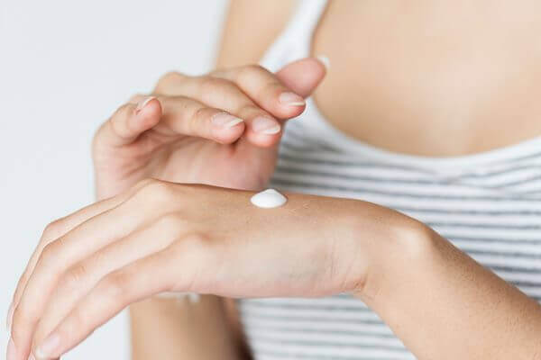 Woman testing the serum on her hand